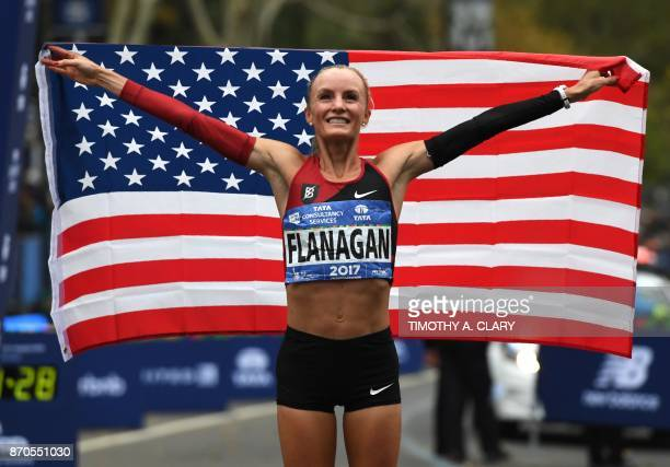 TOPSHOT Shalane Flanagan of the US celebrates after she won the Women's Division during the 2017 TCS New York City Marathon in New York on November 5...