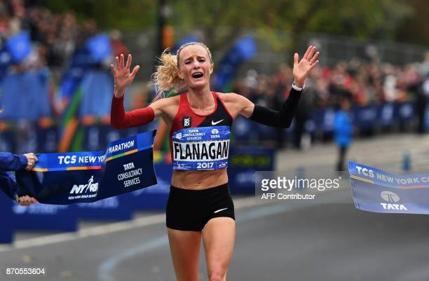 Shalane Flanagan of the US reacts after crossing the finish line to win the Women's Division during the 2017 TCS New York City Marathon in New York...