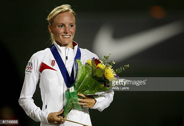 Shalane Flanagan smiles from the podium after receiving the gold medal in the women's 10000 meter final during day one of the US Track and Field...