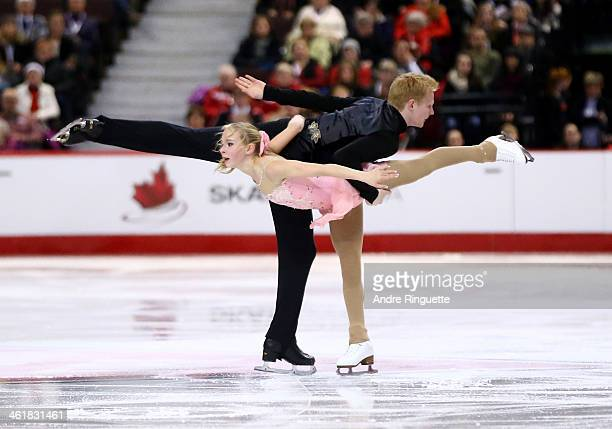 Shalena Rau and Rob Schultz skate in the Senior Pair Free Program during the 2014 Canadian Tire National Figure Skating Championships at Canadian...