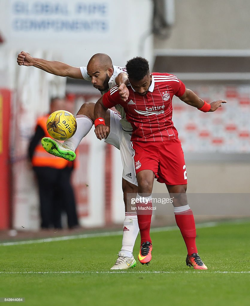 Shaleum Logan of Aberdeen vies with Emmanuel Francoise of CS Fola Esch during the UEFA Europa League First Qualifying Round, First Leg match between Aberdeen and CS Fola Esch at Pittodrie Stadium on June 30, 2016 in Aberdeen, Scotland.