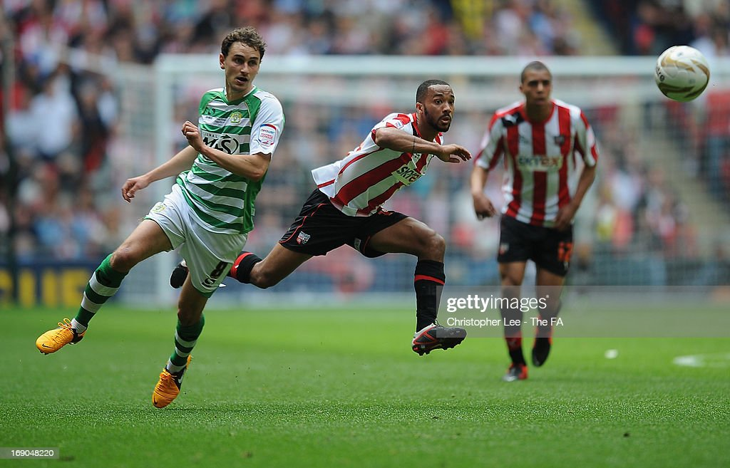 Shaleum Logan of Brentford goes past Edward Upson of Yeovil during the npower League One Play Off Final match bewteen Brentford and Yeovil Town at Wembley Stadium on May 19, 2013 in London, England.