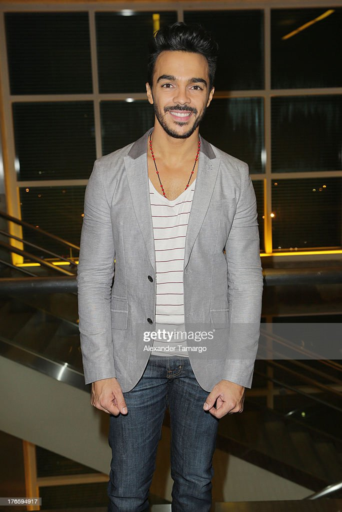 <a gi-track='captionPersonalityLinkClicked' href=/galleries/search?phrase=Shalim&family=editorial&specificpeople=212921 ng-click='$event.stopPropagation()'>Shalim</a> Ortiz poses backstage at Telemundo's Premios Tu Mundo Awards at American Airlines Arena on August 15, 2013 in Miami, Florida.