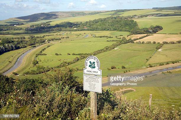 Shallow depth of field Frog Firle National Trust sign High and Over near Alfriston east Sussex England