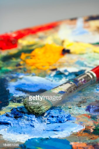 Shallow focus close-up of an artists paint palette and brush