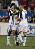 Shalrie Joseph celebrates the first goal of the match with Taylor Twellman and Chris Tierney of the New England Revolution during their match against...