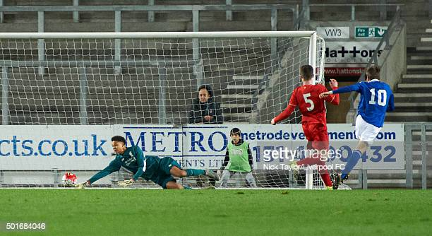 Shamal George of Liverpool saves a shot from Ben Morris of Ipswich Town during the Liverpool v Ipswich Town FA Youth Cup game at Langtree Park on...