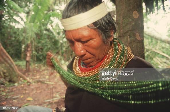 A shaman dons regalia for ayahuasca ceremony Rio Aguarico Ecuador 2009