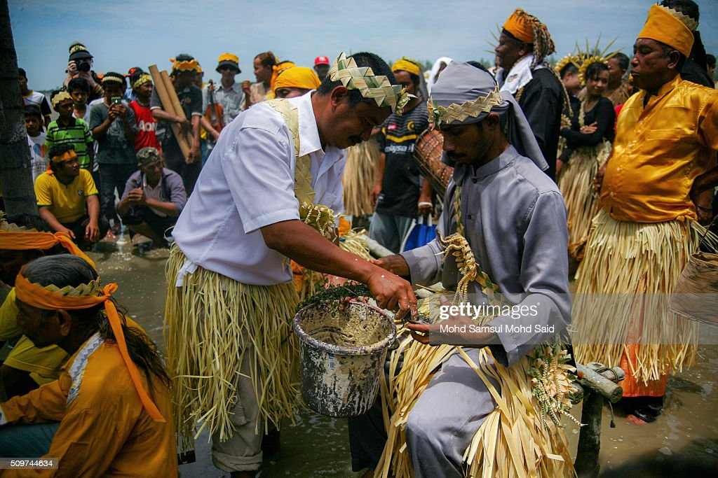 A shaman of Mah Meri tribe carries out their ritual prayer (Puja Pantai), a thanksgiving ritual to appease the spirits of the seas at Pulau Carey, Straits of Malacca beach on February 12, 2016 in Pulau Carey, Malaysia. Every year, the indigenous people of Mah Meri village, located in Pulau Carey, about 140 km (87 miles) southwest of Kuala Lumpur, perform the 'Puja Pantai' ritual prayer and 'Main Jo-oh' dance to appease the spirits of the seas and celebrate the New Year.