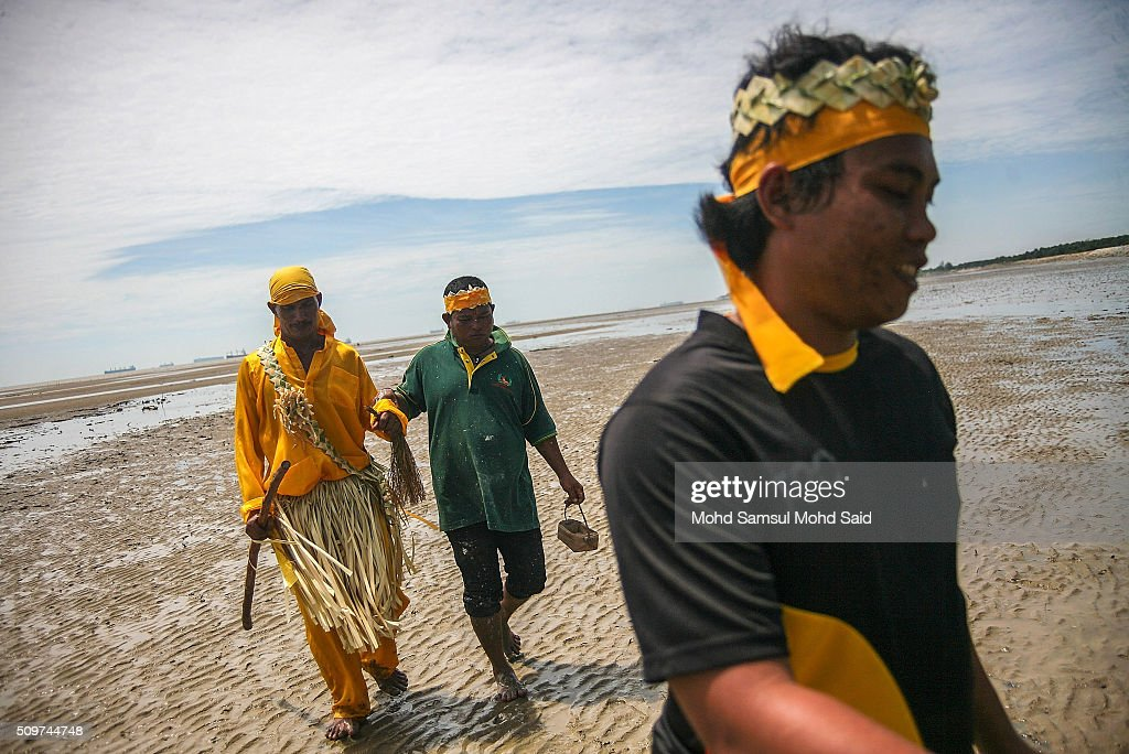 A shaman of Mah Meri tribe walk towards the beach for their 'Puja Pantai', a thanksgiving ritual to appease the spirits of the seas on February 12, 2016 in Pulau Carey, Malaysia. Every year, the indigenous people of Mah Meri village, located in Pulau Carey, about 140 km (87 miles) southwest of Kuala Lumpur, perform the 'Puja Pantai' ritual prayer and 'Main Jo-oh' dance to appease the spirits of the seas and celebrate the New Year.