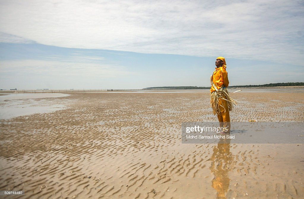 A shaman of the Mah Meri tribe performs prayers on the beach as they offer a prayer to the sea at Pulau Carey, Straits of Malacca beach on February 12, 2016 in Pulau Carey, Malaysia. Every year, the indigenous people of Mah Meri village, located in Pulau Carey, about 140 km (87 miles) southwest of Kuala Lumpur, perform the 'Puja Pantai' ritual prayer and 'Main Jo-oh' dance to appease the spirits of the seas and celebrate the New Year.