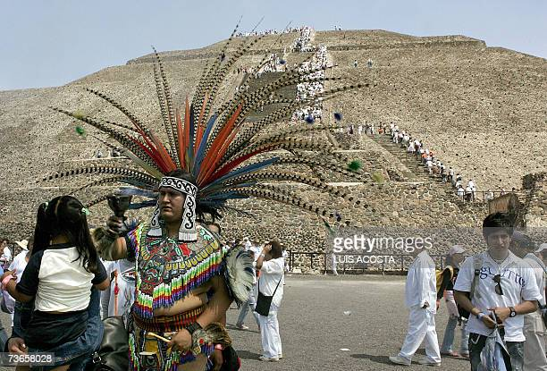 A shaman performs a cleansing ritual as thousands of people climb up the Pyramid of the Sun in Teotihuacan Mexico during the spring equinox 21 March...