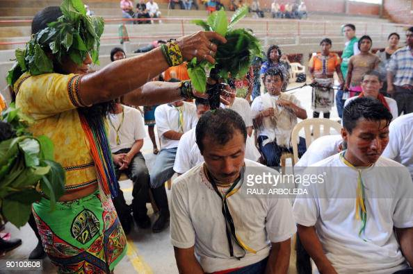 A shaman performs a ritual during the demobilization ceremony for thirtytwo members of the 34th Front of the Revolutionary Armed Forces of Colombia...