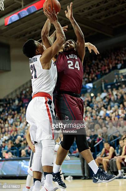 Shamar Johnson of the Loyola Marymount Lions goes to the basket against Rui Hachimura of the Gonzaga Bulldogs in the second half at McCarthey...