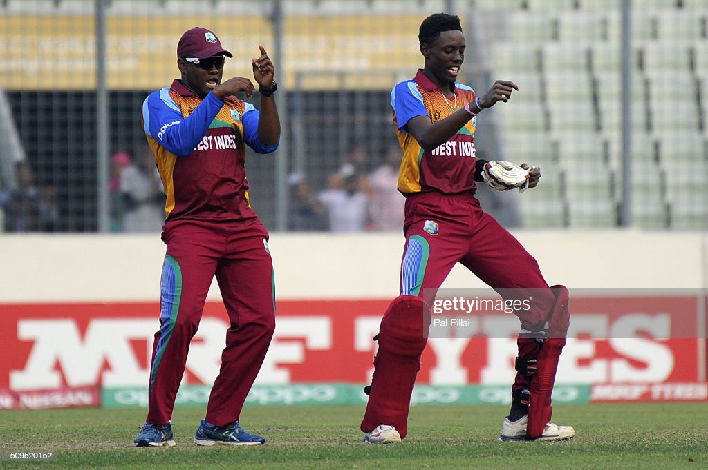 Shamar Springer of West Indies U19 celebrates with teammate Gidron Pope of West Indies U19 after winning the ICC U 19 World Cup Semi-Final match between Bangladesh and West Indies on February 11, 2016 in Dhaka, Bangladesh.