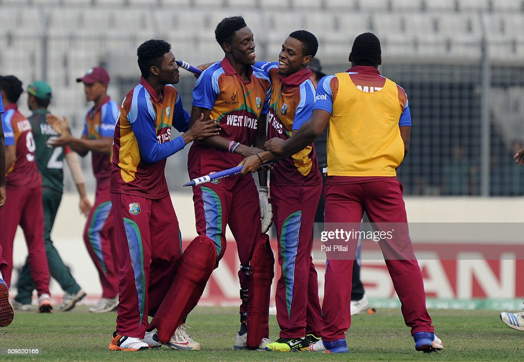 Shamar Springer of West Indies U19 celebrates with teammates after winning the ICC U 19 World Cup Semi-Final match between Bangladesh and West Indies on February 11, 2016 in Dhaka, Bangladesh.