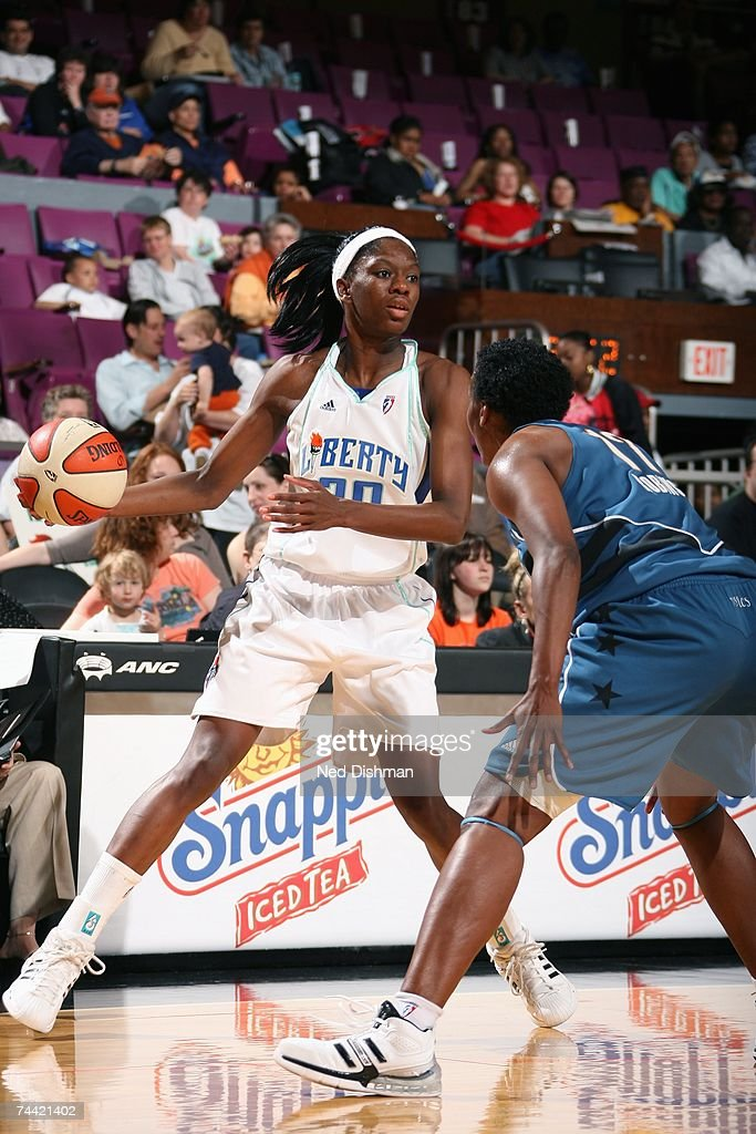 Shameka Christon of the New York Liberty moves the ball against Crystal Robinson of the Washington Mystics during the WNBA game on May 24 2007 at...