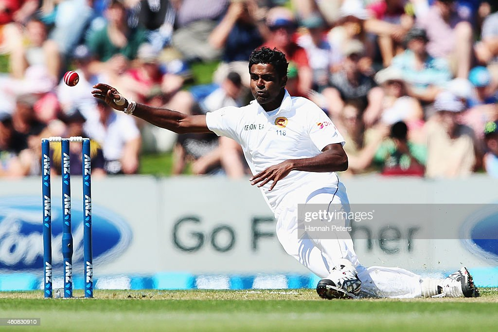 <a gi-track='captionPersonalityLinkClicked' href=/galleries/search?phrase=Shaminda+Eranga&family=editorial&specificpeople=8049726 ng-click='$event.stopPropagation()'>Shaminda Eranga</a> of Sri Lanka falls over as he bowls during the test match between New Zealand and Sri Lanka at Hagley Oval on December 26, 2014 in Christchurch, New Zealand.
