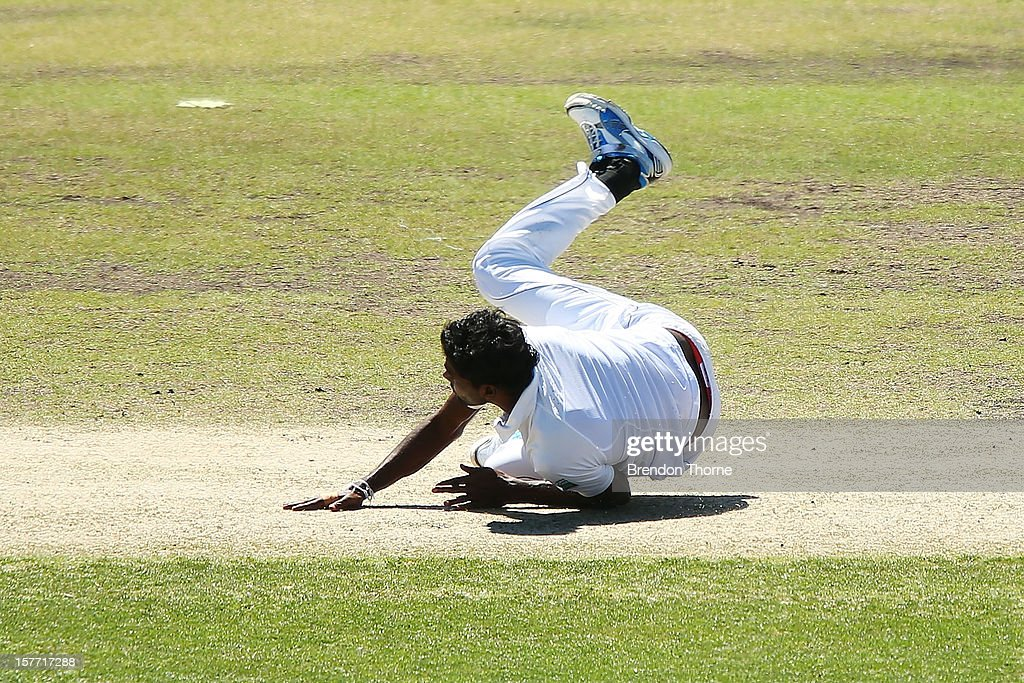 Shaminda Eranga of Sri Lanka falls whilst bowling during day one of the international tour match between the Chairman's XI and Sri Lanka at Manuka Oval on December 6, 2012 in Canberra, Australia.