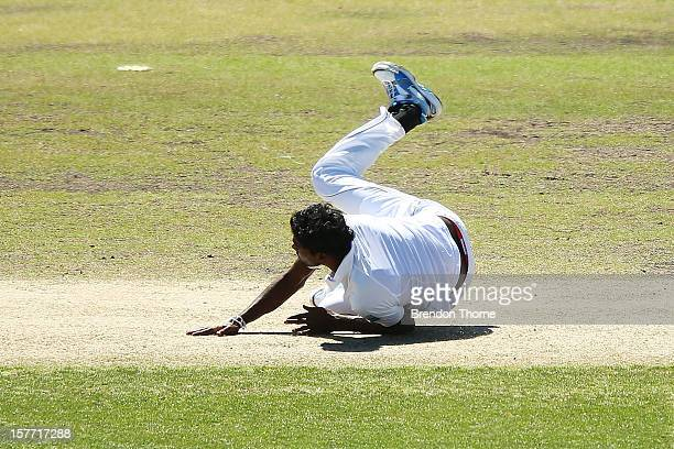 Shaminda Eranga of Sri Lanka falls whilst bowling during day one of the international tour match between the Chairman's XI and Sri Lanka at Manuka...