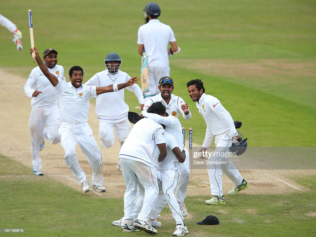 <a gi-track='captionPersonalityLinkClicked' href=/galleries/search?phrase=Shaminda+Eranga&family=editorial&specificpeople=8049726 ng-click='$event.stopPropagation()'>Shaminda Eranga</a> of Sri Lanka is congratulated by his team mates after taking the wicket of James Anderson of England to win the match during day five of the 2nd Investec Test match between England and Sri Lanka at Headingley Cricket Ground on June 24, 2014 in Leeds, England.