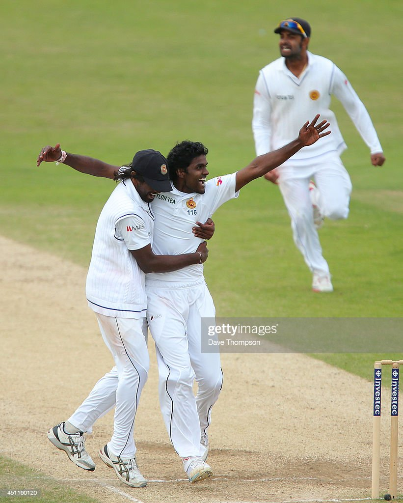 Shaminda Eranga of Sri Lanka, right, celebrates with Nuwan Pradeep of Sri Lanka after taking the wicket of James Anderson of England to win the match during day five of the 2nd Investec Test match between England and Sri Lanka at Headingley Cricket Ground on June 24, 2014 in Leeds, England.