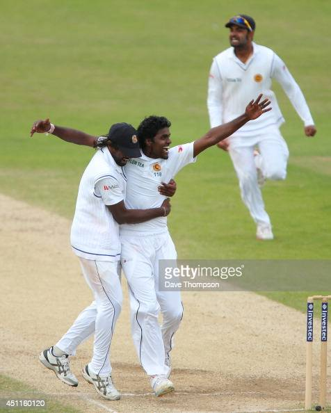 Shaminda Eranga of Sri Lanka right celebrates with Nuwan Pradeep of Sri Lanka after taking the wicket of James Anderson of England to win the match...