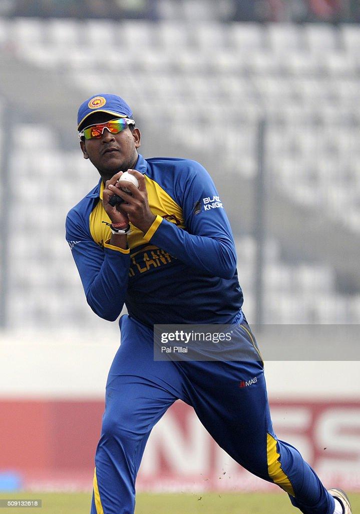 Shammu Ashan of Sri Lanka takes a catch to get the wicket of Sarfaraz Khan of India during the ICC U19 World Cup Semi-Final match between India and Sri Lanka on February 9, 2016 in Dhaka, Bangladesh.