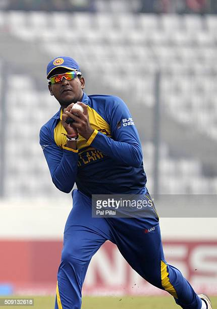 Shammu Ashan of Sri Lanka takes a catch to get the wicket of Sarfaraz Khan of India during the ICC U19 World Cup SemiFinal match between India and...
