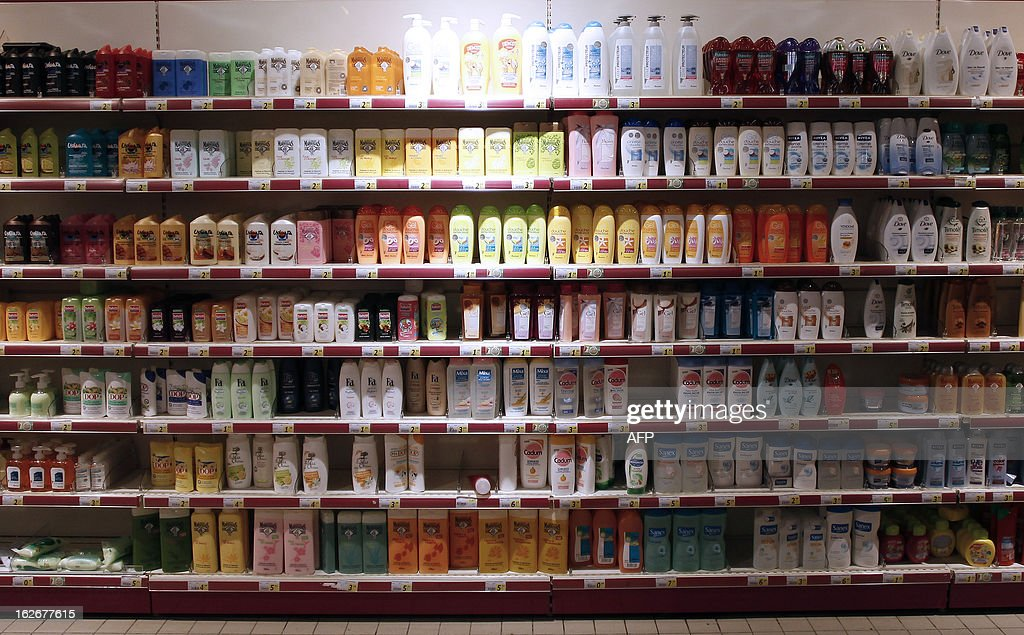 Shampoo bottles are displayed at a supermarket in Herouville Saint-Clair, northwestern France, on February 26, 2013. AFP PHOTO/CHARLY TRIBALLEAU.