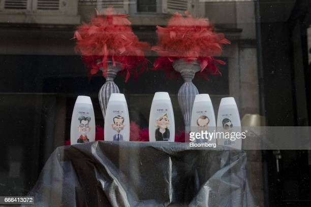 Shampoo bottles with French presidential election candidate caricatures sit on display in the window of a salon in Donzy France on Wednesday March 22...