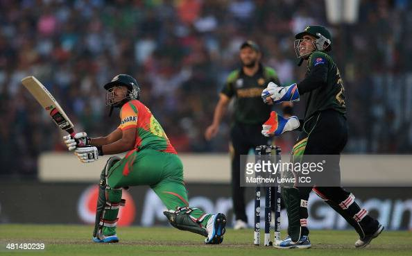 Shamsur Rahman of Bangladesh sweeps the ball towards the bounadry as Kamran Akmal of Pakistan looks on during the ICC World Twenty20 Bangladesh 2014...