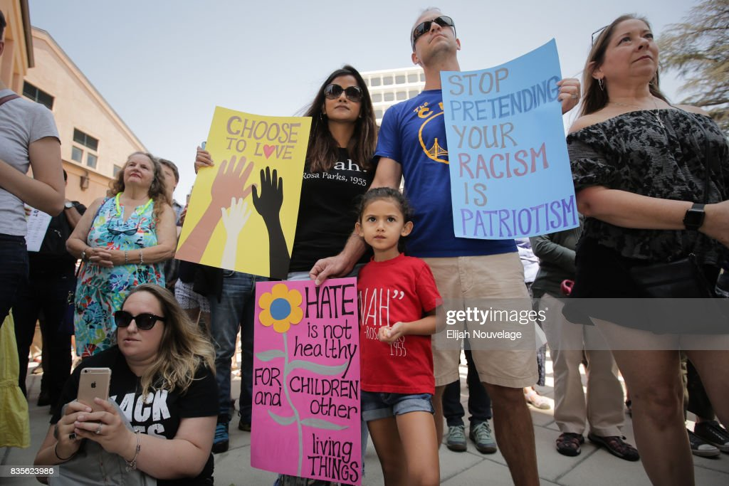 Shana and Luke Farley and their daughter Ariel, 4, of Mountain View, attend a rally against white nationalism on August 19, 2017 in Mountain View, California. Just one week after the violent 'Unite the Right' rally in Virginia that left one woman dead rallies were held around the country in solidarity with Charlottesville.