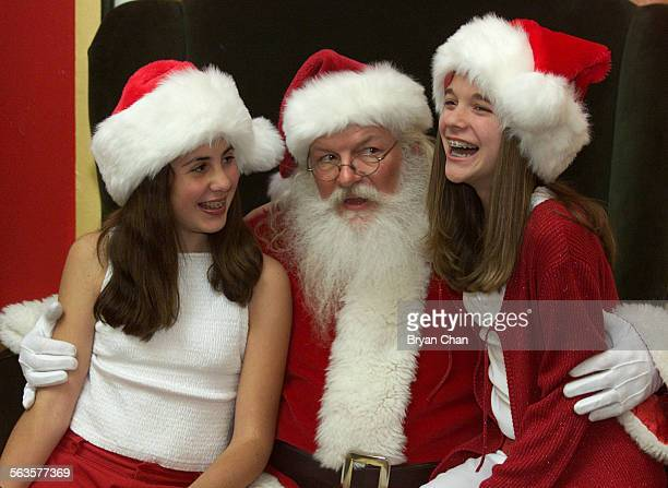Shana Cohen left and Kara Lieberman both 12 let Santa Claus aka Craig Trudeau know what they want for Christmas at the Oaks Mall in Thousand Oaks...