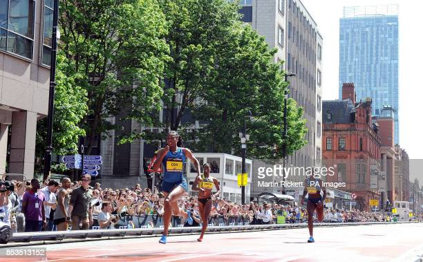 Shana Cox wins the Women's 200m down Deansgate Manchester with StaceyAnn Smith and Christine Ohuruogu during the BT Great CityGames in Manchester...