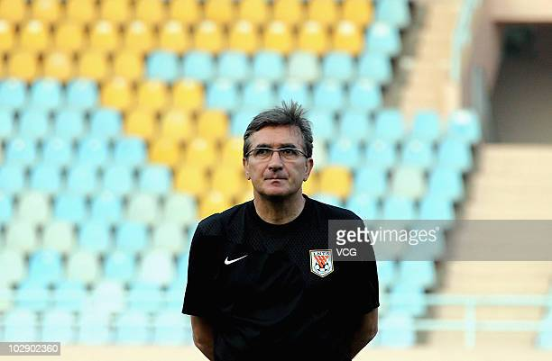 Shandong Luneng coach Branko Ivankovic looks on during a Shandong Luneng training session at Qingdao Tiantai Stadium on July 13 2010 in Qingdao...