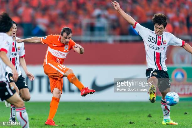 Shandong Luneng FC midfielder Walter Montillo attempts a kick in action during the AFC Champions League 2016 Quarter Final 2nd leg between Shandong...