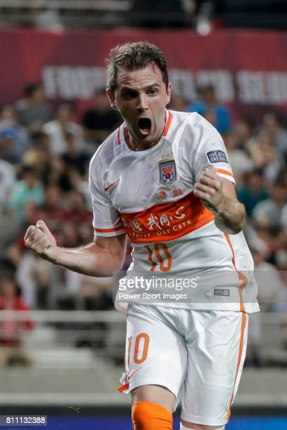 Shandong Luneng FC midfielder Walter Montillo celebrates after scoring his goal during the AFC Champions League 2016 Quarter Final 1st leg between FC...