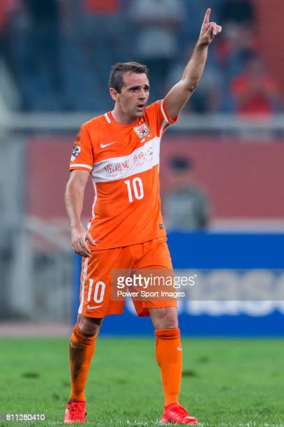Shandong Luneng FC midfielder Walter Montillo celebrates after scoring his goal during the AFC Champions League 2016 Quarter Final 2nd leg between...