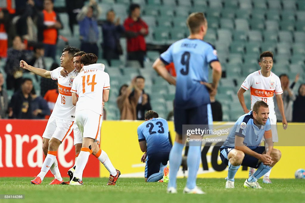 Shandong Luneng players celebrate a draw to progress at the conclusion of the AFC Asian Champions League match between Sydney FC and Shandong Luneng at Allianz Stadium on May 25, 2016 in Sydney, Australia.