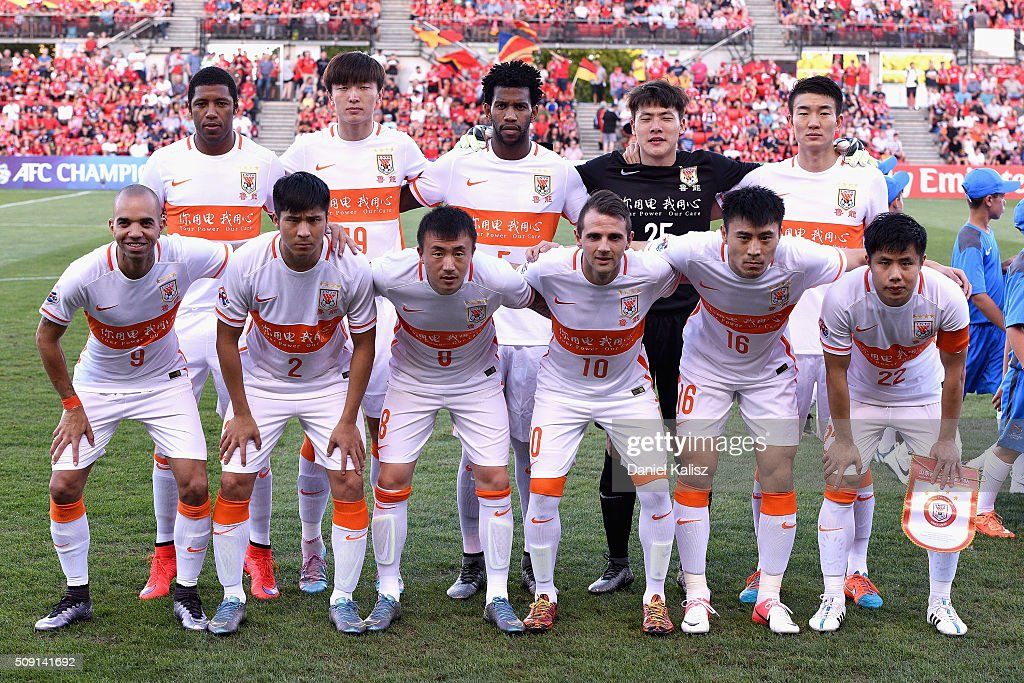 Shandong Luneng players pose for a photo prior to the AFC Champions League playoff match between Adelaide United and Shandong Luneng at Coopers Stadium on February 9, 2016 in Adelaide, Australia.
