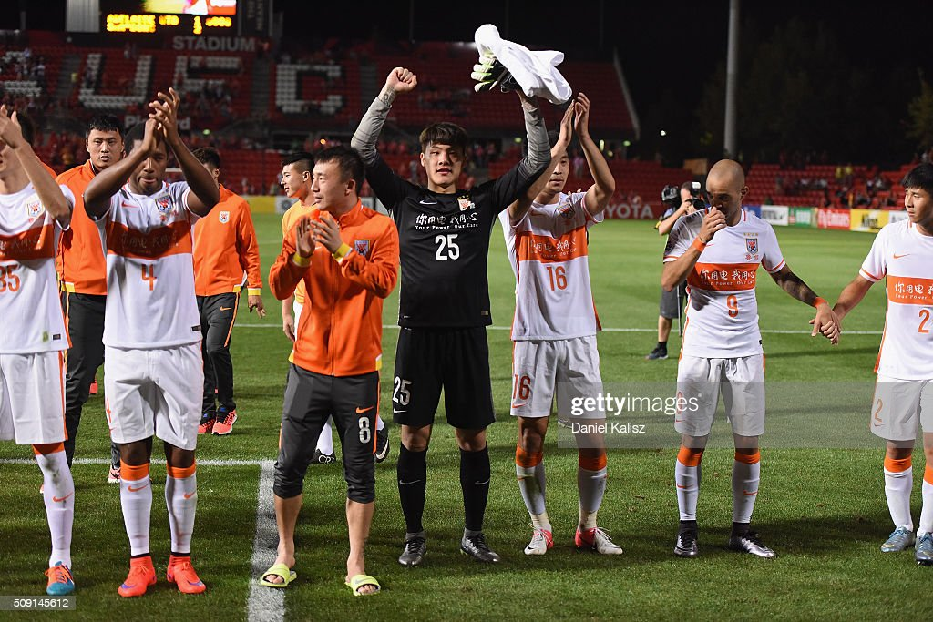 Shandong Luneng react to their supporters after the AFC Champions League playoff match between Adelaide United and Shandong Luneng at Coopers Stadium on February 9, 2016 in Adelaide, Australia.