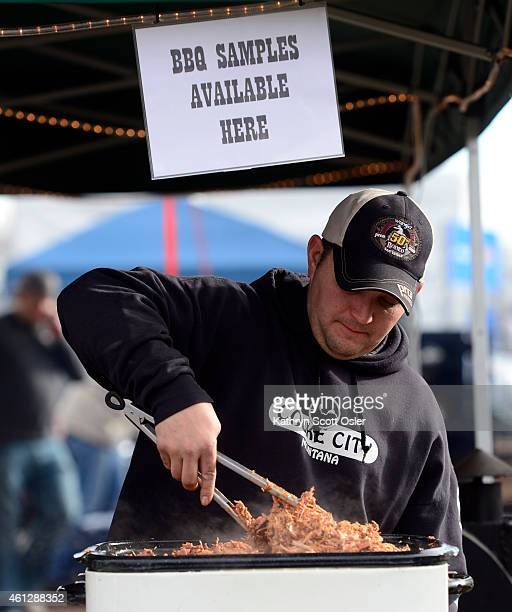 Shane Alexander and his B bar S BBQ Outlaws team from Hill City SD prepares his pulled pork It's opening day for the 109th National Western Stock...