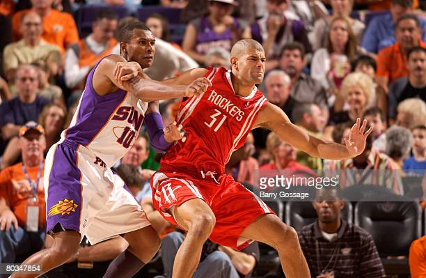 Shane Battier of the Houston Rockets battles for positions with Leandro Barbosa of the Phoenix Suns in an NBA game played at US Airways Center March...