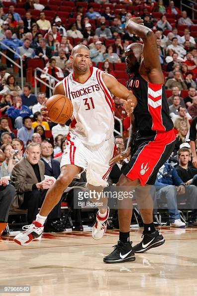 Shane Battier of the Houston Rockets moves the ball against Reggie Evans of the Toronto Raptors during the game on March 1 2010 at the Toyota Center...