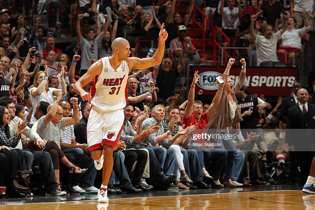 <a gi-track='captionPersonalityLinkClicked' href=/galleries/search?phrase=Shane+Battier&family=editorial&specificpeople=201814 ng-click='$event.stopPropagation()'>Shane Battier</a> #31 of the Miami Heat celebrates after hitting a three pointer against the Dallas Mavericks on January 2, 2013 at American Airlines Arena in Miami, Florida.