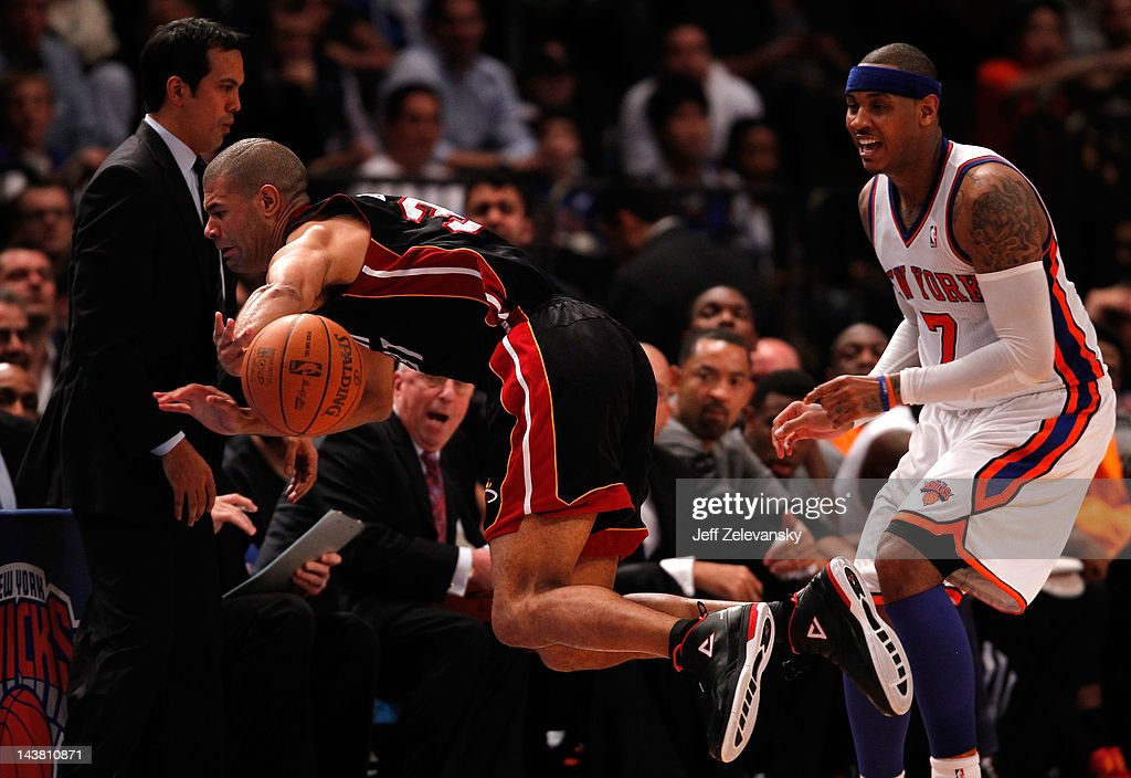 <a gi-track='captionPersonalityLinkClicked' href=/galleries/search?phrase=Shane+Battier&family=editorial&specificpeople=201814 ng-click='$event.stopPropagation()'>Shane Battier</a> #31 of the Miami Heat dives in the air to keep the ball from going out of bounds in the second half against <a gi-track='captionPersonalityLinkClicked' href=/galleries/search?phrase=Carmelo+Anthony&family=editorial&specificpeople=201494 ng-click='$event.stopPropagation()'>Carmelo Anthony</a> #7 of the New York Knicks in Game Three of the Eastern Conference Quarterfinals in the 2012 NBA Playoffs on May 3, 2012 at Madison Square Garden in New York City.
