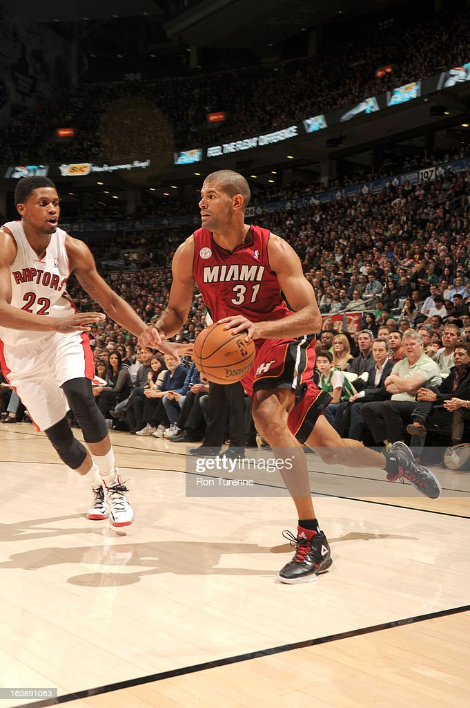 Shane Battier #31 of the Miami Heat drives against Rudy Gay #22 of the Toronto Raptors during the game between the Toronto Raptors and the Miami Heat on March 17, 2013 at the Air Canada Centre in Toronto, Ontario, Canada.