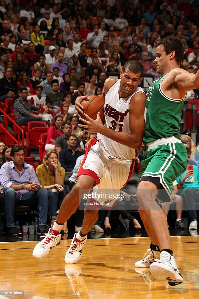 Shane Battier #31 of the Miami Heat drives to the basket against Kris Humphries #43 of the Boston Celtics on November 9, 2013 at American Airlines Arena in Miami, Florida.