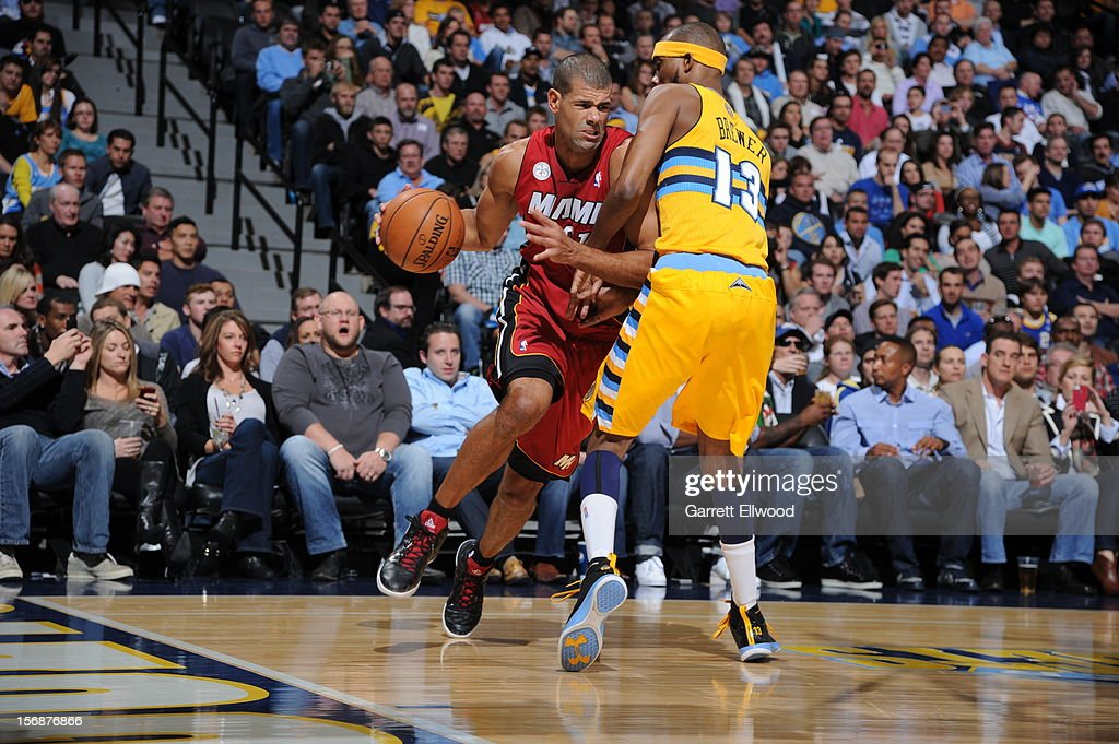 <a gi-track='captionPersonalityLinkClicked' href=/galleries/search?phrase=Shane+Battier&family=editorial&specificpeople=201814 ng-click='$event.stopPropagation()'>Shane Battier</a> #31 of the Miami Heat drives to the basket while guarded by <a gi-track='captionPersonalityLinkClicked' href=/galleries/search?phrase=Corey+Brewer&family=editorial&specificpeople=234749 ng-click='$event.stopPropagation()'>Corey Brewer</a> #13 of the Denver Nuggets on November 15, 2012 at the Pepsi Center in Denver, Colorado.